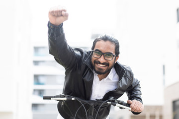Portrait of happy man with bicycle wearing glasses and black leather jacket