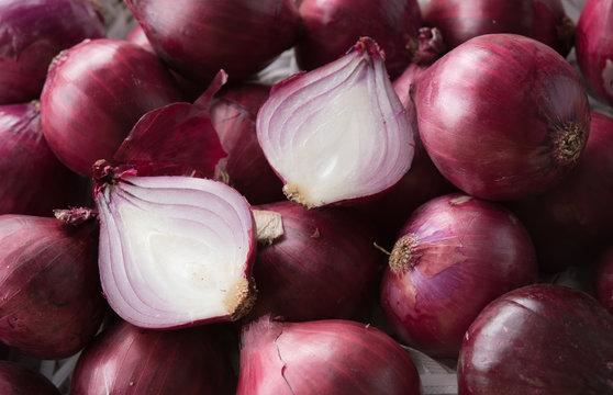Fresh purple onions and one sliced onion
