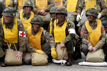 Paratroopers from a World War II demonstration team gather before flying to Normandy in France