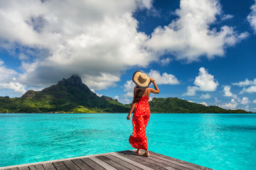 Wall Mural - Bora Bora island luxury resort hotel woman relaxing at view of Mt Otemanu in Tahiti, French Polynesia Honeymoon travel destination for summer vacation.