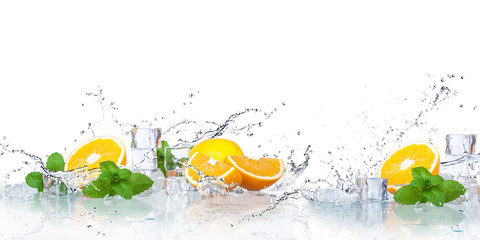 ice cubes, mint leaves with oranges isolated on a white background