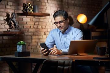Businessman sitting at desk in loft office