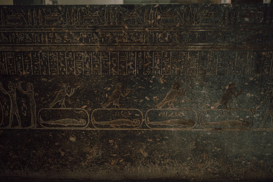 Cairo, Egypt - April, 12 2019: Old wall covered with hieroglyphs in ancient tomb