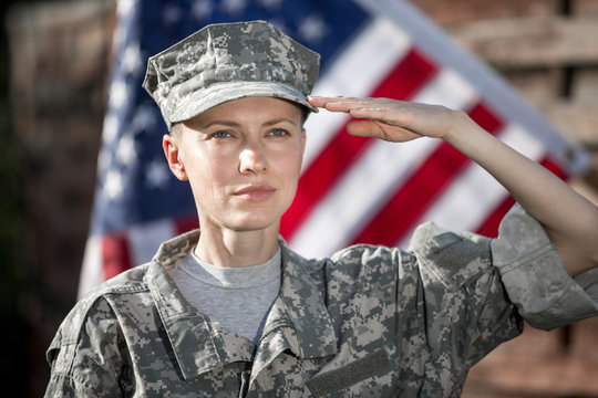 Female US Army Soldier in front of usa flag