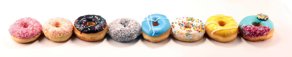 Wall Mural - donuts in different glazes with chocolate