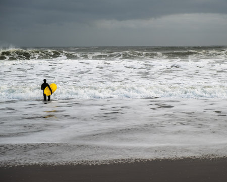 Yellow Surf Board Winter Surfing