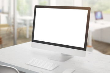 Wall Mural - Modern computer display on white office desk. Isolated screen for mockup, app or web site design presentation. Office interior in background.