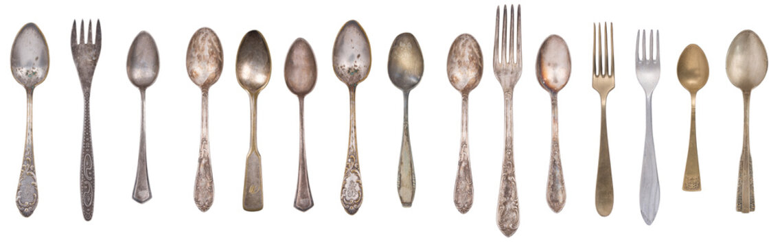 Collection vintage spoons, forks and knife isolated on a white background. Retro silverware