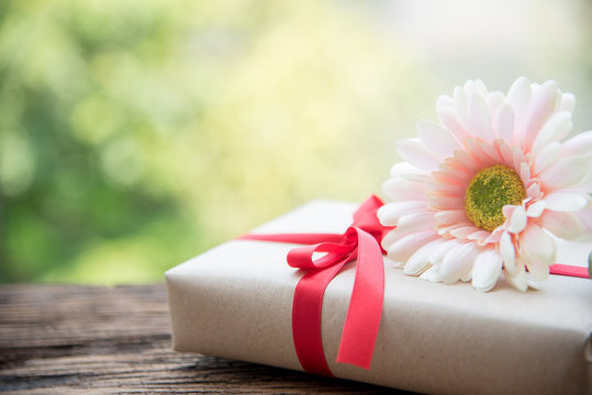red ribbon gift and flower