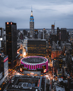 view from top on Madison Square Garden and Empire State Building. Night Lights