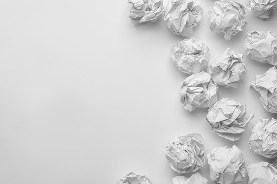 Crumpled sheets of paper on white background, top view