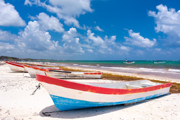Wall Mural - Fishing boats at the beach next to Tulum on the Mayan Riviera