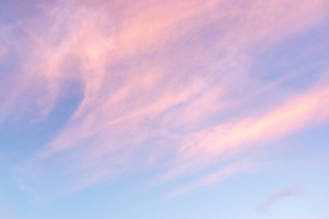 pretty airy pastel colour sky pink purple blue with fluffy cloud for background textures