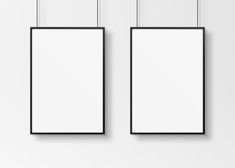 Black frames isolated on wall mockup 3D rendering