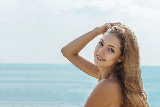 Beautiful smiling woman face  with white teeth, clear skin and with natural makeup.