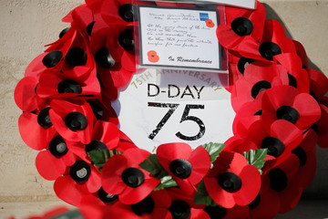 A wreath of flowers is seen before the Royal British Legion's commemoration ceremony for the 75th anniversary of D-Day, at the Commonwealth War Cemetery in Bayeux