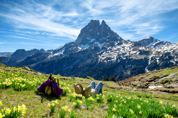 hiker woman resting and looking the Pic du Midi Ossau in the french Pyrenees mountains