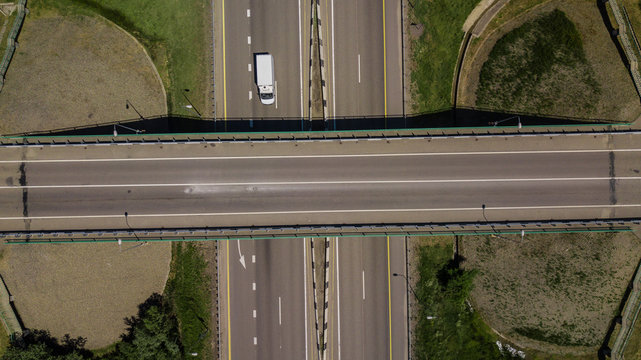 View from above of highway intersection car bridge and moving cars