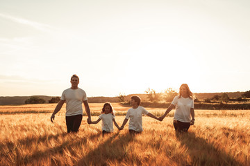 Happy and fun family in nature. Concept of united family having fun and smiling Wall mural