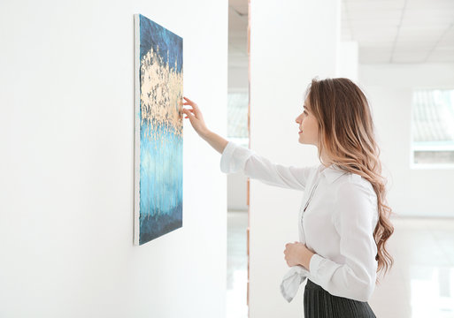 Woman at exhibition in modern art gallery