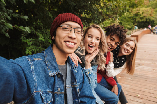 Group if cheerful multiethnic friends teenagers