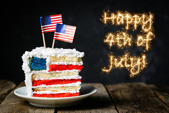 American national holidays concept - 4th of July, layered spounge cake in USA flag colours, rustic background, copy space