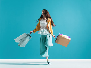 Cheerful young woman enjoying shopping