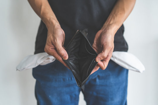 bankruptcy economic financial concept. Person open his empty wallet without money to pay debt in payday.