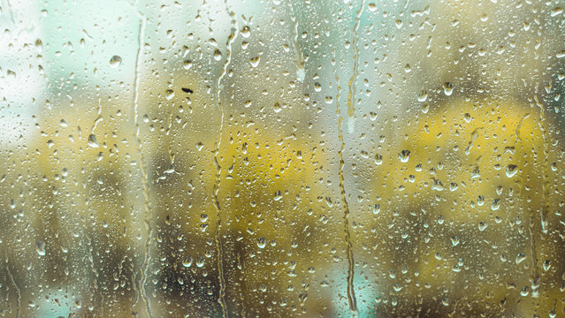 rain drops on the window. rainy window in autumn or spring. abstract view. rainy season. droplets on glass window  shield.