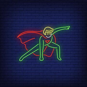 Superhero landing neon sign. Leadership, power, protector design. Night bright neon sign, colorful billboard, light banner. Vector illustration in neon style.