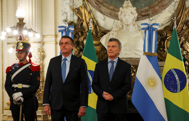 Argentina's President Mauricio Macri, and Brazil's President Jair Bolsonaro pose for a picture at the Casa Rosada government house in Buenos Aires
