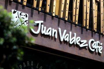 A Juan Valdez logo is photographed outside a store in Bogota