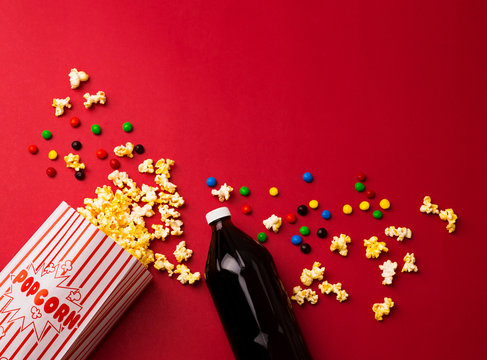 Popcorn and Soda Concession Background with Chocolate Candies