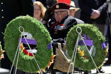 Canadian WWII D-Day veteran Bowen salutes after laying a wreath during a ceremony marking the 75th anniversary of D-Day in Ottawa