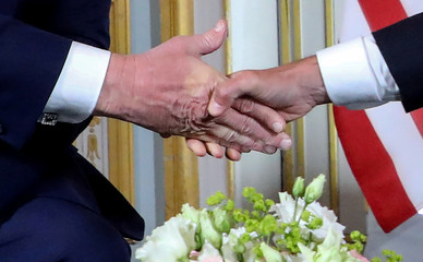U.S. President Donald Trump and French President Emmanuel Macron meet at the Prefecture of Caen, Normandy