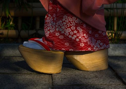 A maiko called chikasaya walking with her traditional maiko clogs, Kansai region, Kyoto, Japan