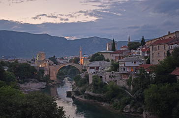 Fotobehang Aubergine Old town of Mostar, Bosnia and Herzegovina, with Stari Most bridge, Neretva river and old mosques