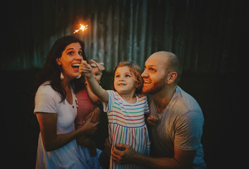 Happy Family doing sparkler fireworks together