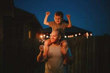 Happy Family doing sparkler fireworks together