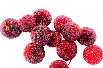 Red bayberry with white background..