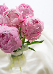 Close up of a bouquet of pink peonies, wedding bouquet, vertical