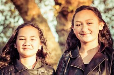 Fototapeta Portrait of two young Maori sisters taken outdoors in a park. obraz