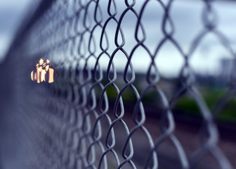 Closeup of chain link fence by railroad tracks
