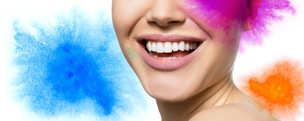 Laughing woman with great teeth with hand drawn multicolored watercolor elements and copy space for text message over white background. Healthy beautiful female smile.