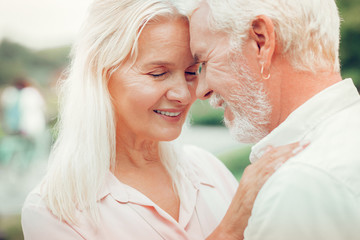 Portrait of a happy positive senior couple