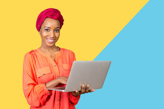 African american woman holding laptop