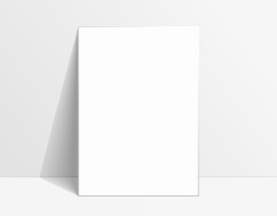 White poster mockup standing on the floor near white wall. Blank Canvas Mockup for design