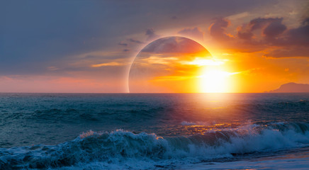 Wall Mural - Beautiful landscape with solar eclipse on the background sunset over the sea