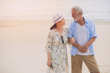 Couple asian wife lovely elder happy care together holiday relax at the beach