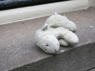 lost sheep, cuddly toy or stuffed animal laying on the windowsill